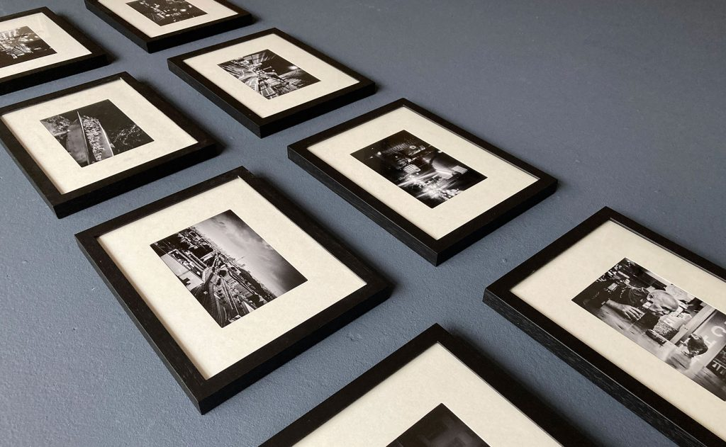 Small Prints in Black Wooden Frames, several Berlin photographs